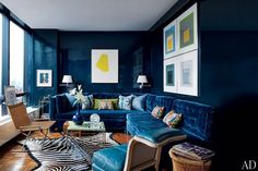 Inside a glass tower overlooking the Manhattan skyline, Todd Alexander Romano created a high-impact design for his 600-square-foot studio. Inspired by the bold color choices of legendary decorator Billy Baldwin, the designer lacquered the walls and upholstered the custom-made sofa in midnight-blue | archdigest.com