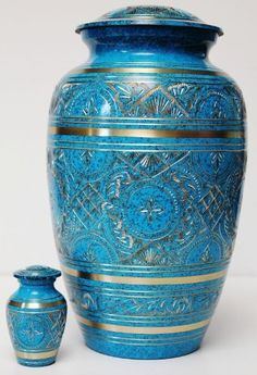 "BEAUTIFUL ADULT BLUE/TURQUOISE FUNERAL CREMATION URN W/FREE KEEPSAKE by Funeralurns. $89.00. Large Urn: This is an adult size, heavy duty solid brass cremation urn with beautiful blue patina finish. It's gorgeously hand engraved by skilled craftsmen. The urn requires no maintenance. It comes with a threaded ""screw-on"" top lid and felt bottom. Height: 10.5"" Width: 6.75"" CU.Inches: approx-230   Keepsake Urn: A matching keepsake is included with the large urn for ..."