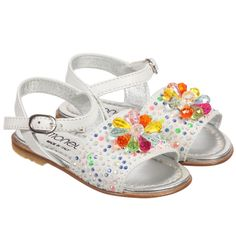 Simonetta girls white soft leather sandals with multicolored studs and beads across the front of the shoe.The strap across the front of the shoe has a buckle fastening. They are lined in soft silver leather and have a non-slip, leather and rubber outer sole.<br /> <ul> <li>Leather upper and lining</li> <li>Lightly padded insole</li> <li>Leather sole with rubber, non-slip inserts</li> <li>Buckle fastening straps</li> <li>Made in Italy</li> </ul>
