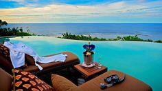 Terrific Infinity Pools Style With Cozy Brown Chaises And Small Table With ...