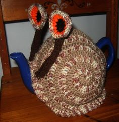 Looking for crocheting project inspiration? Check out Snail spirals tea cosy by member justdunny.