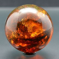 Minerals, Crystals & Fossils - Amber Sphere in UV light - Chiappas, Mexico Crystal Sphere, Crystal Ball, Minerals And Gemstones, Rocks And Minerals, Amber Fossils, Beautiful Rocks, Mineral Stone, Rocks And Gems, Stones And Crystals