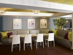 Dining area with cozy banquette seating  #MagreetCevasco #VasiYpsilantis