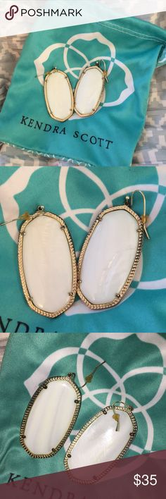 Kendra Scott Danielle earrings in pearl Have had these for a while and never wear them anymore bc I think they're too heavy. They have a good amount of tarnishing. I did clean them and get some of it off. They're still wearable and look fab. Comes with a KS dust bag Kendra Scott Jewelry Earrings