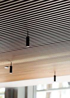 Delicate arches and simple cylinders in a family of lights which can be used singly or in clusters of brilliance. Aluminum heads with acrylic diffusers. Wood Slat Ceiling, Wooden Ceilings, Slat Wall, Ceiling Panels, Wood Panneling, Wall Cladding Panels, Timber Cladding, Home Gym Design, Home Interior Design
