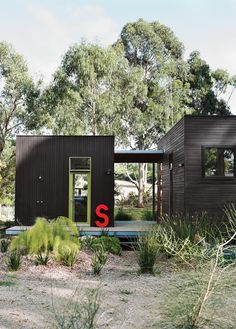 For her family's house near Melbourne, Anna Horne created a series of prefab wood modules using a design from the company Prebuilt. She found the old industrial letter at a factory; it stands for Somerset, the name of the house.  Photo by Lisa Cohen .
