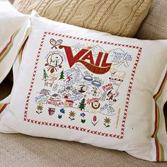 Tea Towel Throw Pillow - Mimic the look of expensive embroidered state pillows by sewing together inexpensive dish towels with designs featuring ski towns or mountainous states.