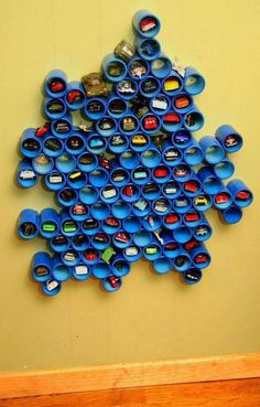 Another super creative ways to store all those Hot Wheels cars or craft supplies, use PVC pipe! Make an artsy design on the wall that acts not only as storage but some stylish texture as well. Then, fill it up with whatever needs to be kept at bay. Pvc Pipe Storage, Kids Storage, Storage Ideas, Toy Car Storage, Organization Ideas, Creative Storage, Storage Design, Wall Storage, Pipe Shelving