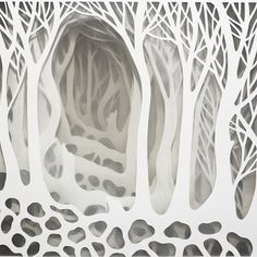 Artist Carefully Cuts Paper into Detailed Layers Playing with Light and Space