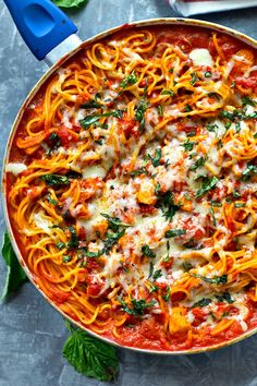 Spaghetti night gets kicked up a notch! This easy creamy chicken tomato basil spaghetti skillet will only take 30 minutes of your busy weeknight and even the pickiest eaters will love it!