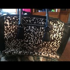 MK purse MK purse. Leather and animal print is faux fur. Barely used. Bags