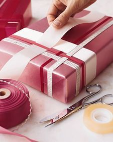 Woven Ribbon Wrap. I've done this many times due to having cats.... cats + curly ribbon/bows = Bad Idea. This is a great and simple way to dress a present up.