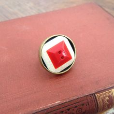 This is a superstar! A big, funky ring Lovingly Krafted from an upcycled vintage button.