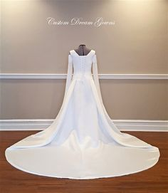 Medieval Wedding Dress by Custom Dream Gowns is a Luxurious Satin A-Line Gown Featuring a Wide V-Neckline, Slim Tank Shoulder Straps, Off Shoulder Satin into Chiffon Bell Sleeves that Form a Point Over the Hand and Extend Downward, Satin Fitted and Boned Bodice, A-Line Skirt, Chapel Train, Corset Back. #medievalweddingdress #celticweddingdress #fairytale #fairywedding #embroidered #medievaldress #beautiful #customweddingdress #weddingdresses