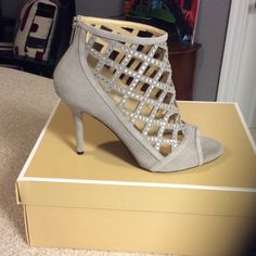 Michael Kors Yvonne Open Toe Bootie Pearl Grey New in Box. Recently purchased! Suade with sparkles on top! Very sexy and eye catching.  3.5 heel. Only tried on one shoe and did not walk around, so I am unsure of comfort level. No trades or sales outside of poshmark! Michael Kors Shoes