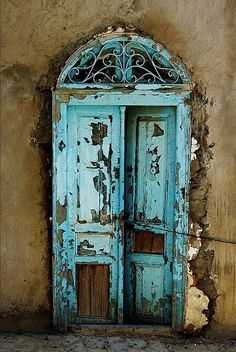 Chipped painted blue door.