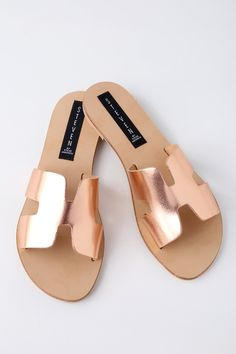 Spend a sunny day exploring Santorini in the Steven by Steve Madden Greece Rose Gold Leather Slide Sandals! Metallic, genuine leather shapes a wide, toe band with notched detail and side cutouts, creating a simple-yet-stylish look that's perfect for everyday wear. Slide-on design.