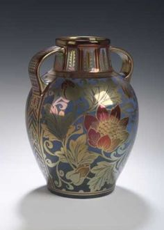 A Pilkingtons Royal Lancastrian twin-handled vase,of ovoid form, painted with opposed panels of flowering rose and peony plants by William S. Mycock , impressed marks, painted monogrammed and dated 1921 24.5cm high