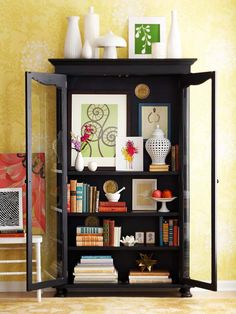 Off The Wall place artwork in cabinet to break up your collections, books and other items in it.
