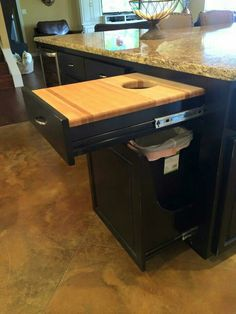 Hidden trash can and cutting board