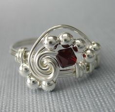 Pi Wire Wrapped Ring Ruby Crystal and Sterling by holmescraft