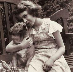 Young Queen Elizabeth II with her corgie Dookie.