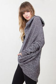 Speckled grey slouchy sweater cardigan. Features dolman sleeve and a hood. Front pockets.