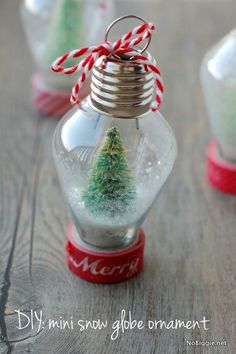 Make a mini snow globe ornament for your Christmas tree. Little bottle brush trees in clear plastic old-fashioned Christmas light ornaments from Joanne's. (Could also use clear round ball ornaments with a bigger tree and more glitter. First Christmas Ornament, Noel Christmas, Diy Christmas Ornaments, Homemade Christmas, Christmas Projects, Winter Christmas, Holiday Crafts, Christmas Bulbs, Ornaments Ideas