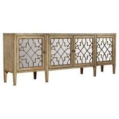 "Four-door mirrored console with a fretwork motif.    Product: Console table   Construction Material: Hardwood solids, oak veneers and mirrored glass     Color: Natural   Features:   Distressed finish   Adds distinction to any room   Beautiful mirror front    Dimensions: 38"" H x 105"" W x 20"" D"