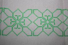 this is an cross stitch pattern to make anything out of for hmong embodies (paj ntaub)