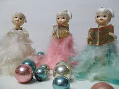 VIntage ceramic and feather Christmas angels. Lovely colors.