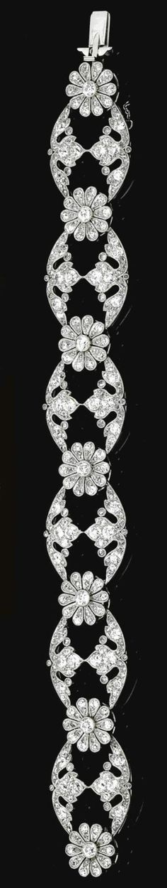 A bracelet of open work and floral design, millegrain set with rose-, single- and circular-cut diamonds, bracelet length approximately 170mm: