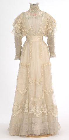 White lace dress made by dressmaker Madame Rose H. Boyd, Minneapolis, Minnesota.