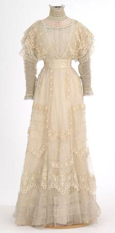 White lace dress made by dressmaker Madame Rose H. Boyd, Minneapolis, Minnesota.
