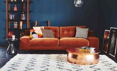 Inspiration - Yuba Mercantile - Inspiration I'm so into moody rooms with dark paint colors. In this one the rust orange couch contrasted with the dark blue walls and black and white Moroccan style rug creates an envy-inducing mood! Blue And Orange Living Room, Orange Rooms, Blue Rooms, Orange Room Decor, Living Room Paint, Living Room Decor, Corner Sofa Small Living Room, Green Living Room Ideas, Blue Velvet Sofa Living Room