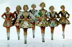 Irish dancers--really do not like the uniformity of the hair styles, but the Celtic designs on the dresses are lovely