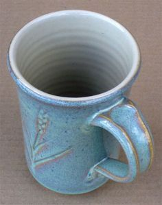 Cone 6 Rutile Blue Ravenscrag Slip glaze. ... This buff stoneware mug is Plainsman M340. The inside transparent is perfect and it is just 80% Ravenscrag Slip and 20% Frit 3134. The outside is 80% Alberta Slip, 20% Frit 3134 and 5% rutile. Also see http://digitalfire.com/4sight/education/alberta_slip_20_years_of_substitution_for_albany_slip_251.html ..... Re use of AB & Albany slips