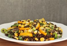 Late summer salad with roasted corn, zucchini and beluga lentils.