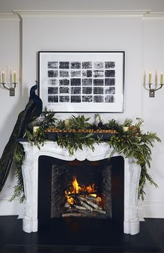 Christmas mantel with garland, walnuts and peacock