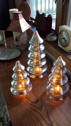 A Goodwill Store find - clear glass becomes beautiful 'mercury' glass. With the flameless tealights inside they become elegant.. All you need is a clean glass object a spray bottle of water & a can of Krylon Looking Glass spray paint Diana Wearing Oregon, WI   #crafts mercury glass tree,  seasonal holiday decor