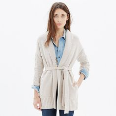 With its generous length and cozy textured merino wool, this wrap cardigan was made for those freezing cold days when all you want to do is curl up by the fire and wish the snow away.
