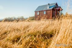 This 112-square-foot mobile cabin belongs to extreme skier Zac Giffin, the host of FYI's Tiny House Nation, a show that features people from across the country who are living the tiny house lifestyle. The tiny abode is home to Giffin and his girlfriend, skier Molly Baker. Built on a trailer, the house features a little wood stove, living space, and a lofted guest bedroom and storage area accessed by a floating staircase. Built by Giffin for almost $25,000, the structure took seven weeks to…