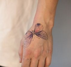 Beautiful butterfly on hand by River