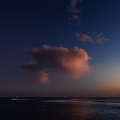A lonely cloud floating.  Taken from Nobbys Head, Newcastle, Australia. While on a photowalk with The Photowalk Guys.