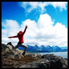 Happy girl at the Dønna mountain. The Seven Sisters in the distance. #jumpstagram #nordland #norway
