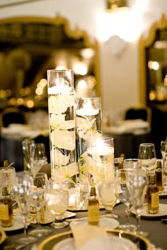 Wedding Centerpiece: Submerged Cymbidium Orchids beneath Floating Candles  http://scarletpetal.typepad.com/weblog/dennis-lee-photography/