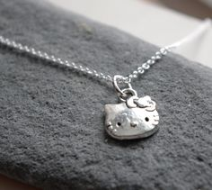 Hello Kitty charm on a delicate sterling necklace... free shipping and gift. $19.00, via Etsy.