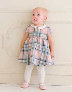 Princess Diana Tartan   100% pure wool made in Scotland   12% of the price goes to charity   Fully lined in 100% cotton   Gently elasticated half cap sleeves    Beautifully crafted, our rose pink tartan baby dress is the perfect option for playtime and parties! Ultra-soft and never scratchy, the Princess Diana Tartan is woven in Scotland. The dress is fully lined in 100% cotton. Pretty half cap sleeves are gently elasticated, and allow plenty of room to grow, while the full gathered skirt…