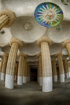 The columns of the hypostyle hall hold up the terrace of Gaudi's Parc Guell. The bowled mosaic ceiling is adorned with these decorated discs, each with a unique design.