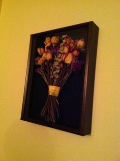 Dried flowers in a shadow box.